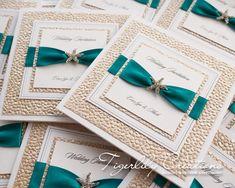 """Cleopatra"" Wedding Invitations with starfish crystal brooch, champagne pebble paper and Malibu ribbon. Perfect for a destination wedding. #destinationwedding #marriedabroad #beachwedding #abroadwedding #starfishwedding #seasidewedding"