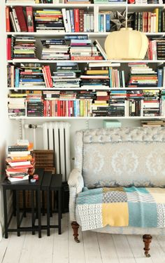 I'd love to spend an afternoon curled up here. Big fan of that couch, too...