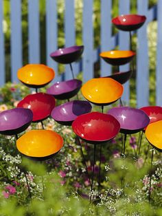 "Poppy Sways, Set of 5 (3 sets in photo)  -- Powder-coated steel, copper plate; Approx. 4"" W x 24"" H; Add an extra splash of color to your garden. These steel poppies sway in the breeze and collect rainwater for butterflies or can be filled with a scattering of birdseed -- Gardener's Supply Company"