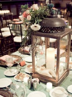 Lantern and a candle for centerpieces...simple but elegant!