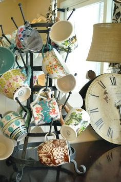 A great way to display and use cofffee/tea cups and mugs! Old french drying rack..