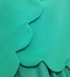 scalloped edges on an amanda uprichard dress