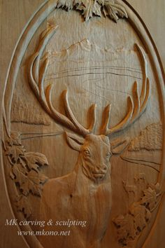 "Title: Elk door carving  Material: Clear Alder  Panel size: WxHxD 21""x36""x1.5"""