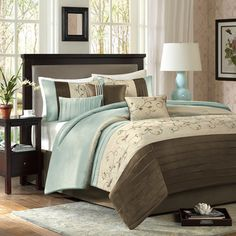 Spruce up your bedroom with this stylish Madison Park Grace seven-piece comforter set. Hues of tan and brown pair with refreshing aqua that are embellished with tiny embroidered flowers for a romantic