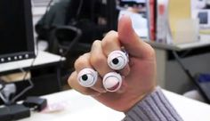 Wacky robotic jewelry out of Japan has motorized eyes and a mouth to make your hands more expressive.