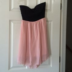 Cute strapless dress Strapless pink and black dress with bow and open back! Only worn once! Wet Seal Dresses Strapless