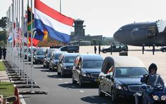 23 JULY 2014 King Willem-Alexander of the Netherlands stands with Queen Maxima of the Netherlands and Dutch Prime Minister Mark Rutte as unidentified bodies from the crash of Malaysia Airlines flight MH17 are transferred to hearses on July 23, 2014 in Eindhoven, Netherlands. Today the people of the Netherlands are holding a national day of mourning.
