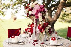 Red table setting styled by Silverberry Occasions. Photo by @Rowell Photography. Floral by @Rachel A. Clingen