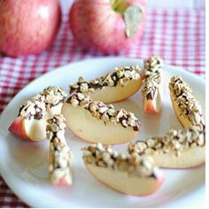 Apple slices with nutella dipped in granola....yummy healthy snack.