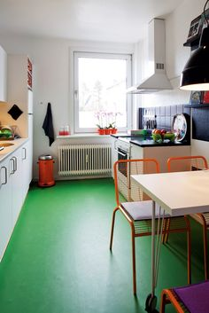 green floor!!    small, bright eat-in kitchen in Denmark (Andreas Mikkel Hansen for Bo Bedre)
