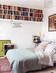 Hanging Bookshelf in the bedroom. Great idea to save space