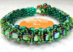 Supersized Orblet Banglet $65.00. Peyote stitched Miyuki cube beads as the base of the bracelet, embellished with Czech iridescent cubes and Miyuki seed beads. Decorative flower button and loop closure. Based on the original design by Kelly Dale, Off The Beaded Path. #beadsintoart