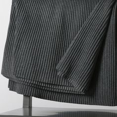 PLEECE THROW BLANKET / Design House Stockholm Fashion fades, only style remains the same. This scarf with hood is useful as it is beautiful and unique. It's part of the Pleece collection, created in 1997 by Marianne Abelsson, based on the same timeless simplicity and quality that never goes out of style. The fabric is still manufactured and pleated in Borås, Sweden. And it is still one of Design House Stockholm's best selling products.
