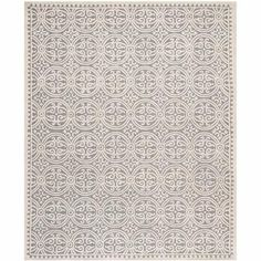 A little different patternm, but very pretty.  It is wool. Safavieh Cambridge Hand Tufted Wool Area Rug