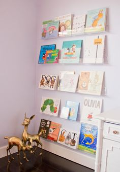 "Greeting card displays used as book shelves! $8 for 24"" wide http://cleardisplays.com/card-display/greeting-card-holder/card-shelves-with-holes-for-hanging/"