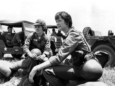 U.S. Army nurses Capt. Gladys E. Sepulveda, left, of Ponce, Puerto Rico, and 2nd Lt. Lois Ferrari, of Pittsburgh, Pa., rest on sandbags at Cam Ranh Bay in South Vietnam, July 14, 1965 during the Vietnam War. They are awaiting transportation to Nha Trang, where they will work in the 8th field hospital.