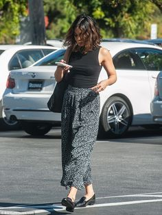 Engrossed: Vanessa wore black patent brogues on her feet and accessorised with a slouchy b...