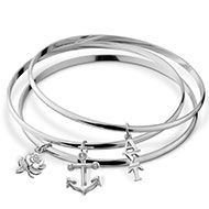 Trendy set of three fine silver-plated bangles; each bangle has a silver plated charm (rose, vertical letters, anchor) ...