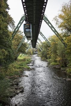 The world's oldest electric elevated railway runs through Wuppertal, Germany. It was first opened over 100 years ago, in Places Around The World, People Around The World, Around The Worlds, Double Decker Bus, Mode Of Transport, Travel Goals, Short Stories, Places To Travel, Identity