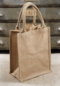 Natural Burlap Jute 11x9 Tote Bags with Handles (6 bags)  $18 for 6 bags     For packaging gift prints. Throw a stamp on it and some pink tissue?