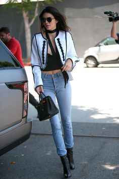 2 June Kendall Jenner was spotted having lunch with fellow model Gigi Hadid. She wore an embroidered monochrome jacket and skinny jeans. - HarpersBAZAAR.co.uk