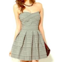Garcia Strapless Bandage Dress Gray and Black strapless dress by Garcia. Hugs the curves and bottom bells out to accent the legs. 100% polyester. No trades, reasonable offers  Garcia Dresses