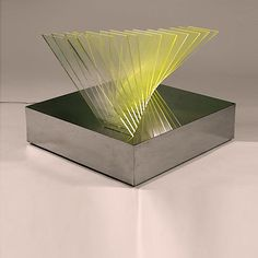 """""""New Lamp"""" model unknown (A Variation on the Spaziale Lamp) designed by Gianfranco Fini (1942-?) circa 1970.  Fourteen plexiglass rectangles through which light is emitted through small cut-outs in a mirror polished stainless steel base"""