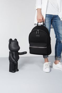 Black backpack crafted in neoprene and vegan leather.