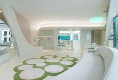 Curvy white nature inspired interior with white resin floor