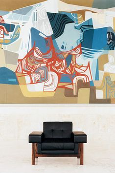 This painting is by a Brazilian artist Roberto Burle Marx.  I love it because it reminds me of a Picasso's Guernica....as an added bonus the chair is also pretty swanky!