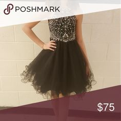 Girls special occasion dress Gorgeous dress worn once.  It is a size 10 with no alterations.  The back zips half way then ties.   It is black.  It comes from a smoke free and pet free home.   The condition is like new. Cinderella Couture Dresses Formal