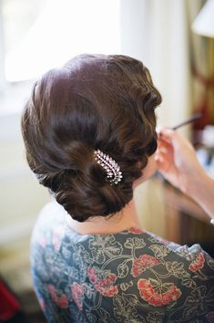 bride with 1930s inspired finger waved updo
