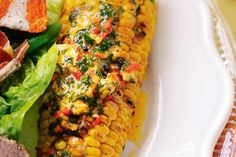 Spice up sweet corn on the cob with a spread of chilli-herb butter. Buttered Corn, Surf And Turf, Christmas Lunch, Herb Butter, Barbecue Recipes, Butter Recipe, Vegetable Sides, Food Hacks, Sweet Corn