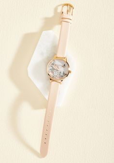 When asked for the time, you're always thrilled to share, for you're always sporting this Enchanted Garden watch by Olivia Burton! Delicate dusty rose and ivory blooms are framed by gleaming rose gold details atop the face of this pastel pink, leather-banded timepiece, making it a pleasure to watch minutes pass.