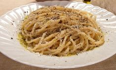 "Literally ""cheese and pepper"", this minimalist cacio e pepe recipe is like a stripped-down mac and cheese. Cacio E Pepe Recipe, Melted Cheese, Vegetarian Cheese, Mac And Cheese, How To Cook Pasta, Pasta Dishes, Bon Appetit, Delish, Spaghetti"