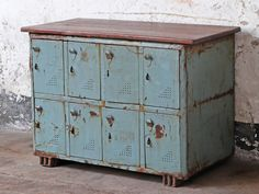 A striking vintage industrial locker unit with an upcycled hardwood table-top. Scaramanga contends that this flexible piece of storage and display furniture would be a great addition to any room in the home. Vintage Bedroom Furniture, Bedroom Vintage, Repurposed Furniture, Kitchen Furniture, Furniture Ideas, Industrial Lockers, Vintage Industrial, Vintage Kitchen Cabinets, Vintage Cabinet