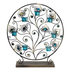 Peacock Tealight Display evokes the plumes of its namesake with intricate scrollwork and jeweled stones. Tinted tealight holders complement magnificent blue and green gems for a stunning display. Decorative Accessories, Home Accessories, Peacock Bedroom, Peacock Pillow, Blue Home Decor, Feather Design, Peacock Design, Home Living, Living Room