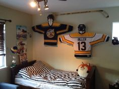 Cool hockey room! The jersey displays can be bought at Sport Interiors (www.sportinteriors.com) for $49 each, the jerseys are private.