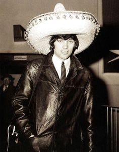 Manchester United footballer George Best wearing a souvenir sombrero on his return to London following uniteds defeat of Benfica 5-1 in the second leg of the European Cup quarter final. Best scored United's first two goals - 11 March 1966