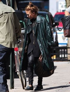 OLSENS ANONYMOUS MK MARY KATE OLSEN FASHION STYLE BLOG GREEN TRENCH COAT JACKET CHAIN COLLAR NECKLACE FENDI BAG LEATHER PANTS ROUND SUNGLASSES BUN CROC GREEN LOAFER FLATS BLACK BUTTON UP