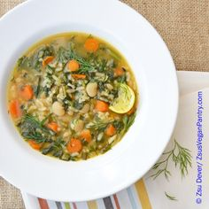 Zsu's Vegan Pantry: spring kale and dill soup with rice. The soup is freshened with #lemon juice. It is a light vegan soup with beans, rice, kale, carrots and dill. Quick and easy, it is ready in about 15 minutes.