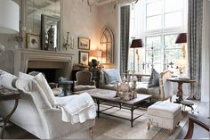 The living room has a high ceiling and a beautiful fireplace.  I love the Aidan Gray day bed instead of a second sofa.