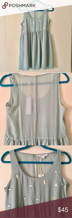 """NWT BCBGeneration embellished baby doll dress silver triangle jewels and soft gold jewels contrast a soft sea mist shift style for a comfy, flirty fit. sheer back to the waist, with a large keyhole; hook and eye closure behind the neck. 100% polyester. bust measures 18"""" across, waist 17.5"""" , length 33"""". BCBGeneration Dresses Mini"""