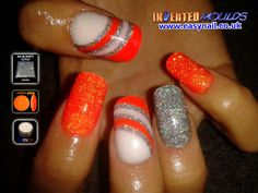 How cool are these!!  For the index and little finger start by applying a very thin layer of glitter acrylic, allow to cure a little and then 'back' it in the Mega Neon Orange :-)  Created by Cheryl Hammond using Inverted moulds with our French White, Mega Neon Orange and Silver Glitter.  IM Nail Training Available from www.easynail.co.uk