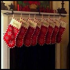stockings hanging on a curtain rod with 3 stocking holders.  Just a great idea I thought I'd share...