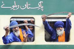 Indian Sikh Nihang (religious Sikh warriors) raise their swords after boarding a train along with devotees to Pakistan at a railway station in Amritsar. Thousands of Indian Sikh pilgrims are expected in Pakistan for the Baisakh celebrations, the Sikh New Year at the Sikh Shrine of Gurudwara Panja Sahib and Nankana Sahib, the birthplace of Sikh faith founder Guru Nanak Dev, some 75 km southwest of Lahore.