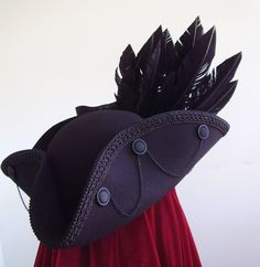 Black raven tricorn hat for the Hatter? Pirate Cosplay, Pirate Garb, Pirate Wench, Pirate Steampunk, Raven Wings, Pirate Queen, Pirate Fashion, Fancy Hats, Renaissance Fair