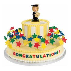 A bold graduation cake gets the nod for our fun bobbling topper and colorful fondant stars on wires.  What better occasion than graduation for this kind of color and energy?
