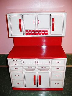 We have one of these for Molly! 1950s tin KITCHEN CABINET retro toy by Wolverine red and white detailed via Etsy.
