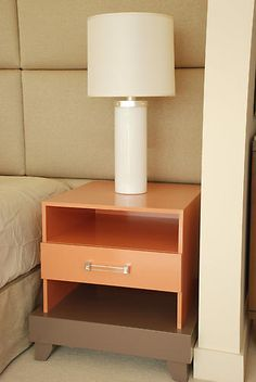 I love this custom built nightstand.  How modern yet classy!  Great and unexpected choice of colors.